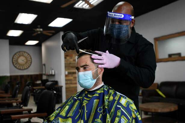 Neno Lopez gives a long awaited haircut to David DiScala, of Norwalk, at Neno Clips barbershop at 56 North Main Street in Norwalk, Conn. on Monday, June 1, 2020. DiScala said he normally gets his haircut every two weeks.