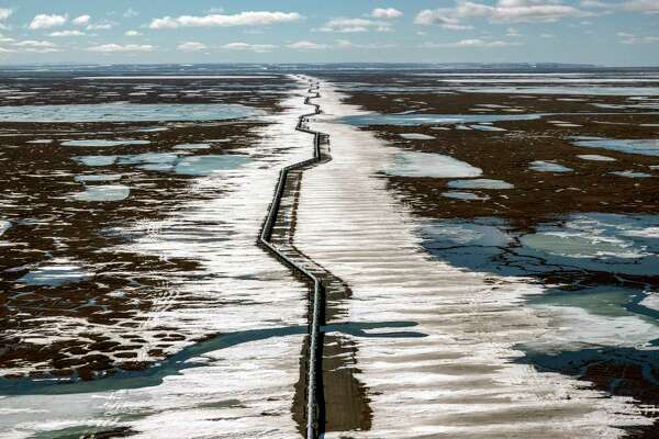 An oil pipeline stretches across the landscape outside Prudhoe Bay in North Slope Borough, Alaska.