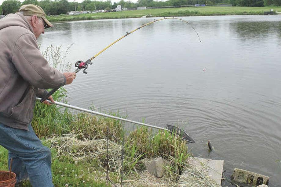 Charlie Jobe of Jacksonville fishes Monday at Lake Mauvaisterre.