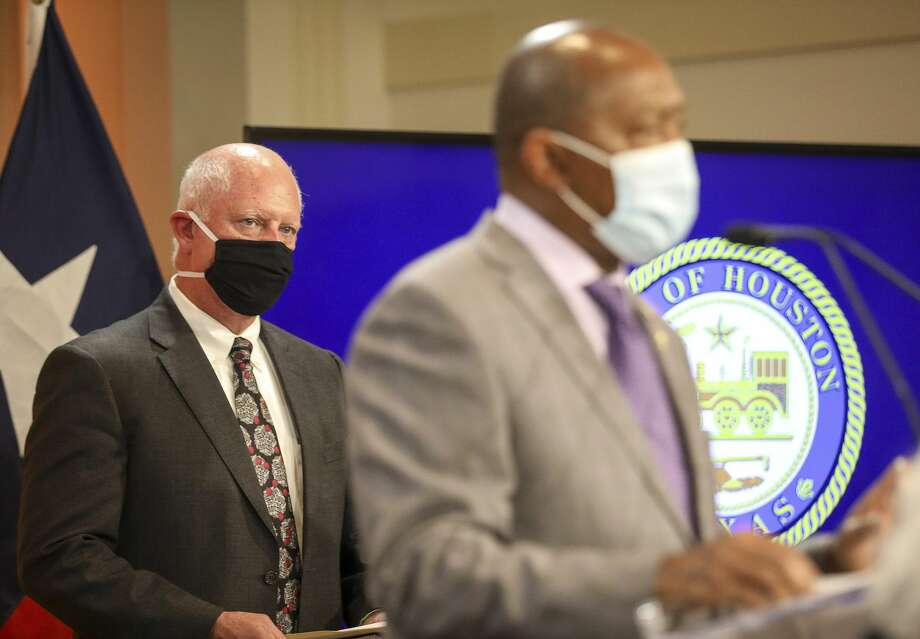Dr. David Persse, health authority for the City of Houston, listens as Houston Mayor Sylvester Turner speaks during a press conference Monday, June 1, 2020, at City Hall in Houston. Photo: Jon Shapley/Staff Photographer / © 2020 Houston Chronicle