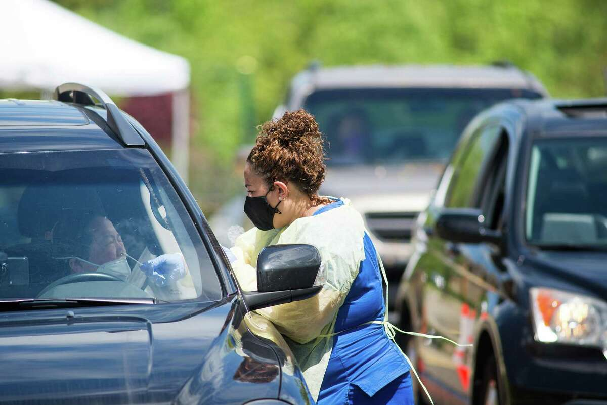 RIdgefielders turned out for drive-through coronavirus testing Saturday, May 30 a the town Recreation Center.