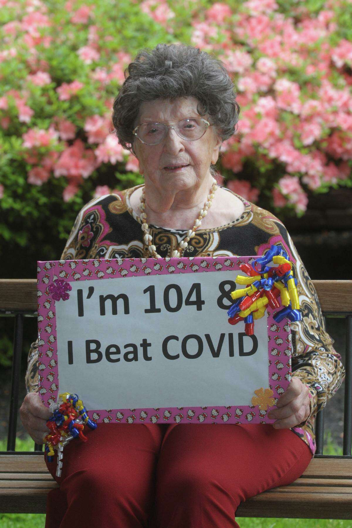 Lora Bartult, age 104, poses in front of Maefair Health Care, in Trumbull last week.