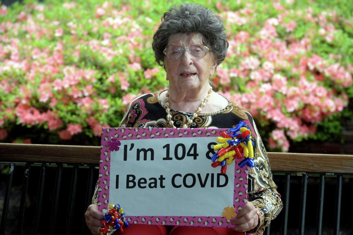 Lora Bartult, age 104, poses in front of Maefair Health Care, in Trumbull, Conn. May 28, 2020. Bartult is has recovered after being diagnosed with coronavirus and is also a survivor of the Spanish Flu of 1918.