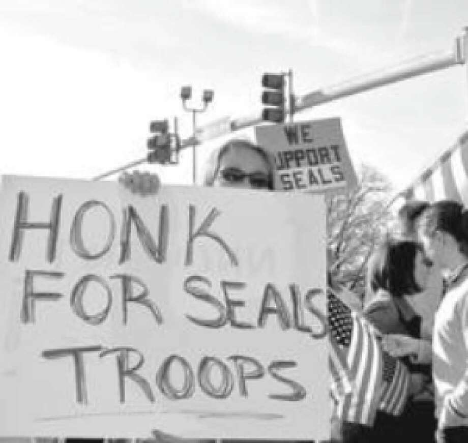 Norfolk resident Susan Lindsey was among roughly 75 demonstrators who gathered outside Norfolk Naval Base this month to protest the court martial of three Navy SEALs.