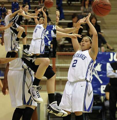 Courtney Rhodes of Clark is surrounded by Jay defenders as she passes off.
