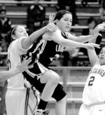 Clark's Courtney Rhodes passes out of pressure from Jay defenders Vanessa Orr (left) and Destiny Amezquita on Saturday. Amezquita scored a team-high 17 points off the bench in a 67-34 victory over Clark.