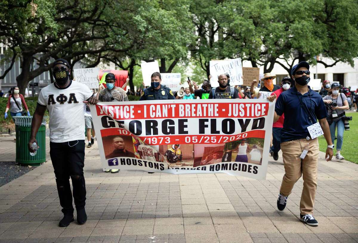 Protestors at a Black Lives Matter event rally and honor George Floyd in downtown Houston on Friday, May 29, 2020. Floyd was killed by police in Minneapolis earlier this week.