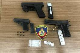 Two firearms and one pistol, which poilce seized during a raid at two Ludlow Street addresses late Friday afternoon, May 30, 2020.