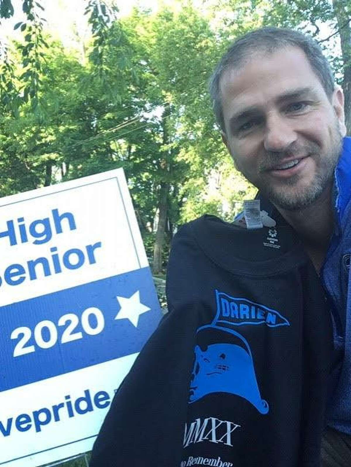 Darien High School seniors were surprised by the school's teachers and administration Monday as they dropped off commemorative t-shirts for each graduate.