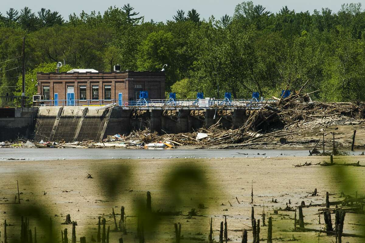 FILE - Debris remains piled up against the Sanford Dam Monday, June 1, 2020 in Sanford. (Katy Kildee/kkildee@mdn.net)
