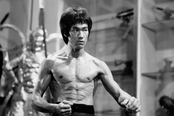 Actor and martial artist Bruce Lee poses for a Warner Bros publicity still for the film 'Enter the Dragon' in 1973 in Hong Kong.
