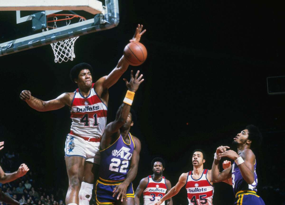 WASHINGTON - UNDATED: Washington Bullets' Wes Unseld #41 jumps and blocks a shot by a Utah Jazz player during a game at Capital Centre circa the 1970's in Washington, D.C.. NOTE TO USER: User expressly acknowledges and agrees that, by downloading and/or using this Photograph, User is consenting to the terms and conditions of the Getty Images License Agreement. (Photo by Focus on Sport via Getty Images)