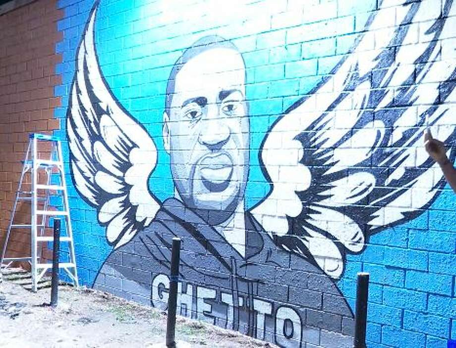 The new mural honoring George Floyd is located at the Scott Food Mart, 3341 Winbern Street, Houston. Artists: Donkeeboy  & Mandi Quintanilla Photo: Courtesy OnSceneTV