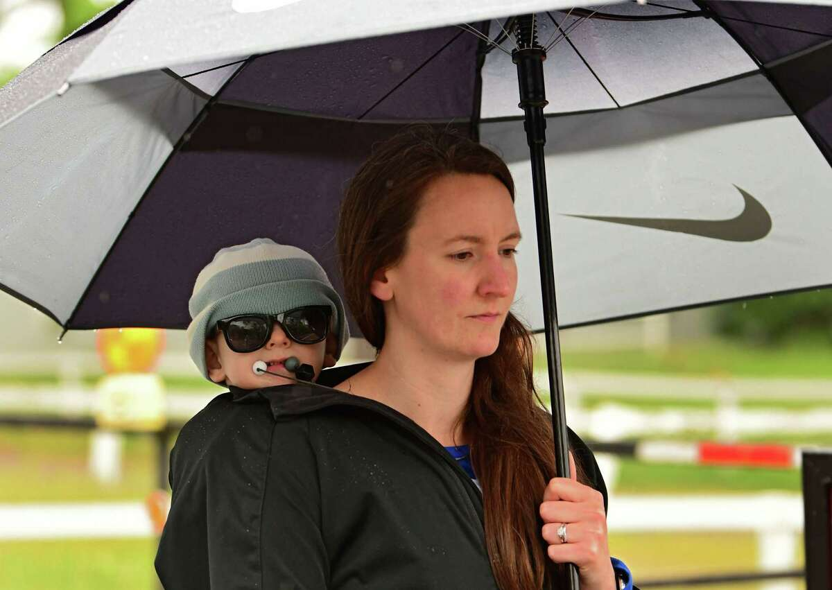 Amy Gray of Saratoga Springs uses an umbrella as she walks down Union Avenue with her 2-year-old son on Tuesday, June 2, 2020 in Saratoga Springs. (Lori Van Buren/Times Union)