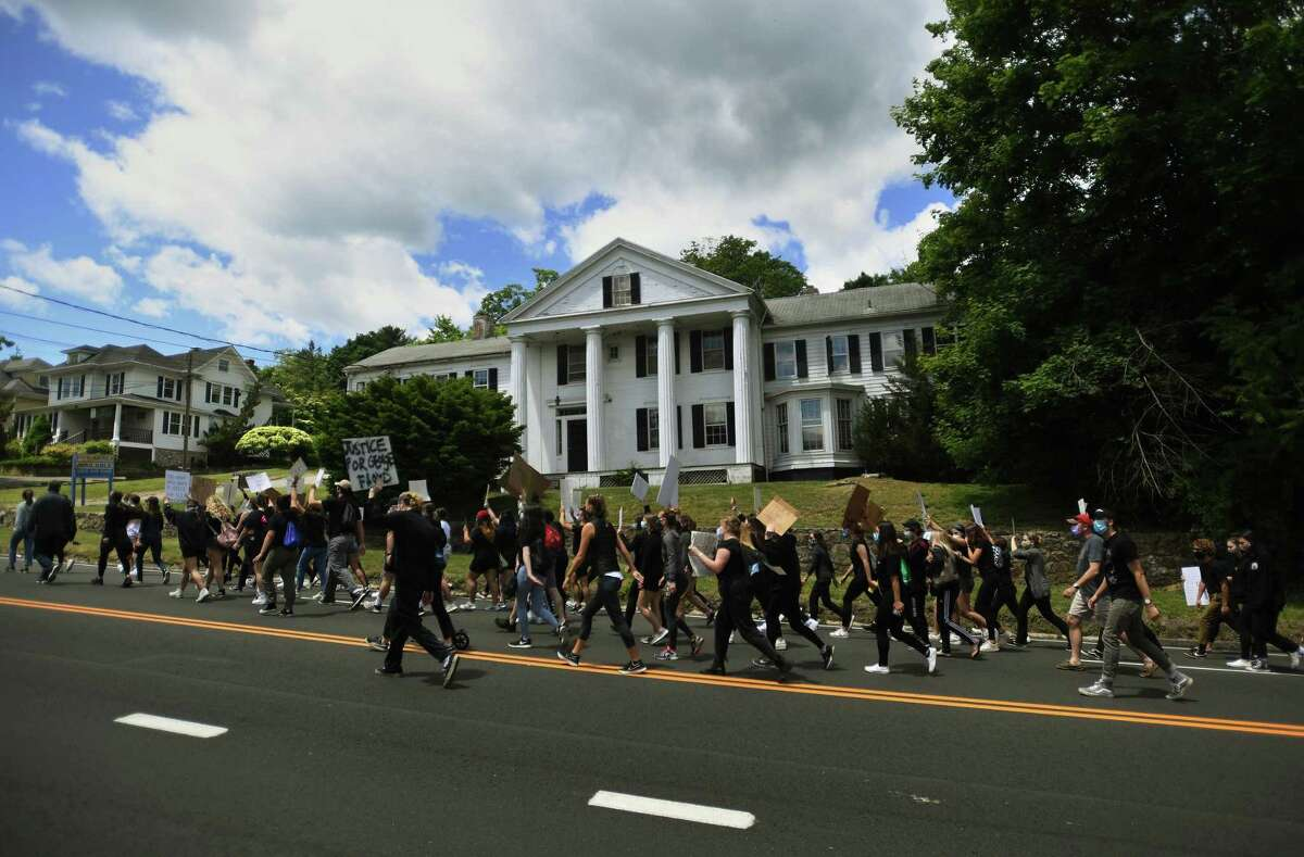 Protestors march up the Post Road chanting slogans in a Black Lives Matter protest in Westport this week.