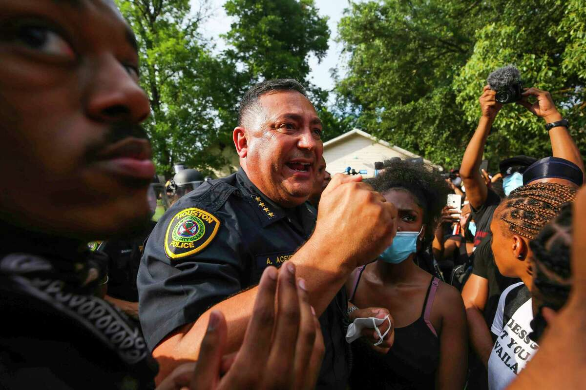 Houston Police Chief Art Acevedo talks with protesters during a rally on Saturday, May 30, 2020, for George Floyd, a Houston native who died in custody of the Minneapolis police.