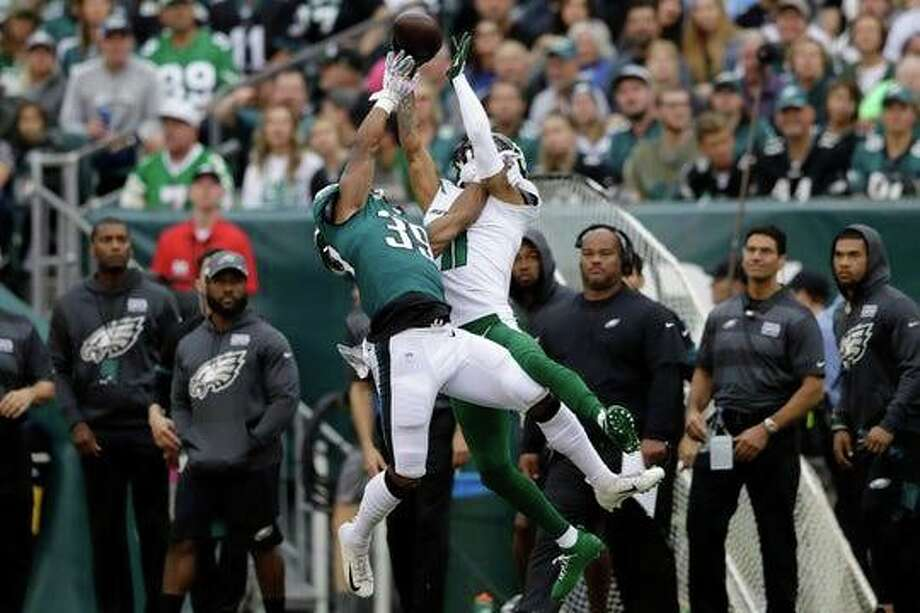 Eagles cornerback Craig James, left, defends a pass intended for Jets receiver Robby Anderson during a 31-6 win. Photo: Associated Press