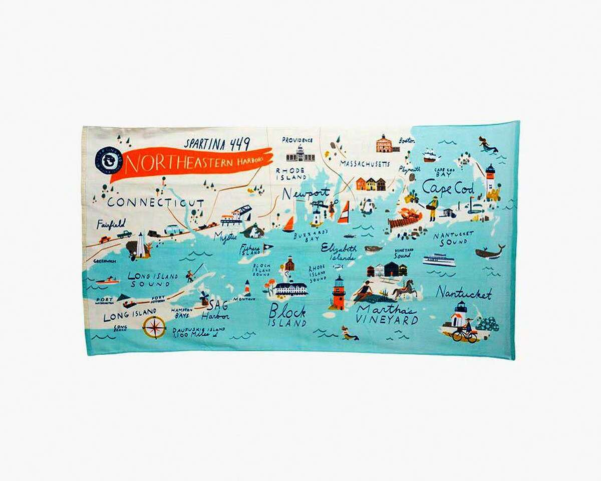 A 100% cotton quilted throw, available from The Dock Shop in Darien and Westport, features a colorful graphic of Northeast harbors, and could be hung on the wall, thrown over an armchair, or used for a spontaneous picnic.