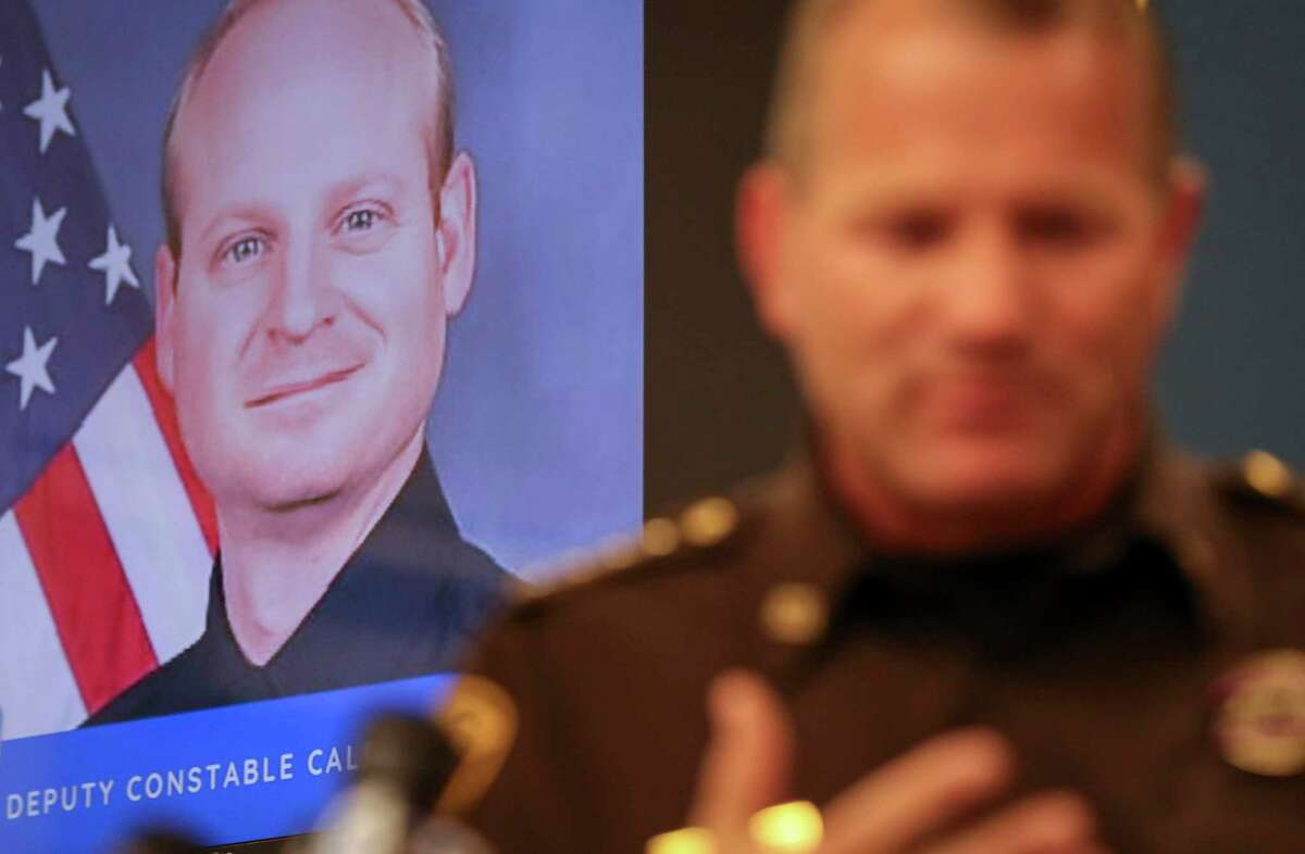 A photo of Fort Bend County Precinct 4 Deputy Constable Caleb Rule is seen as Fort Bend County Sheriff Troy Nehls speaks during a press conference Friday, May 29, in Richmond. Earlier in the morning, a Fort Bend County Deputy Sheriff fatally shot Rule after mistaking him for an intruder as they cleared a house in nearby Missouri City. Rule was flown to Memorial Hermann hospital, but he did not survive.