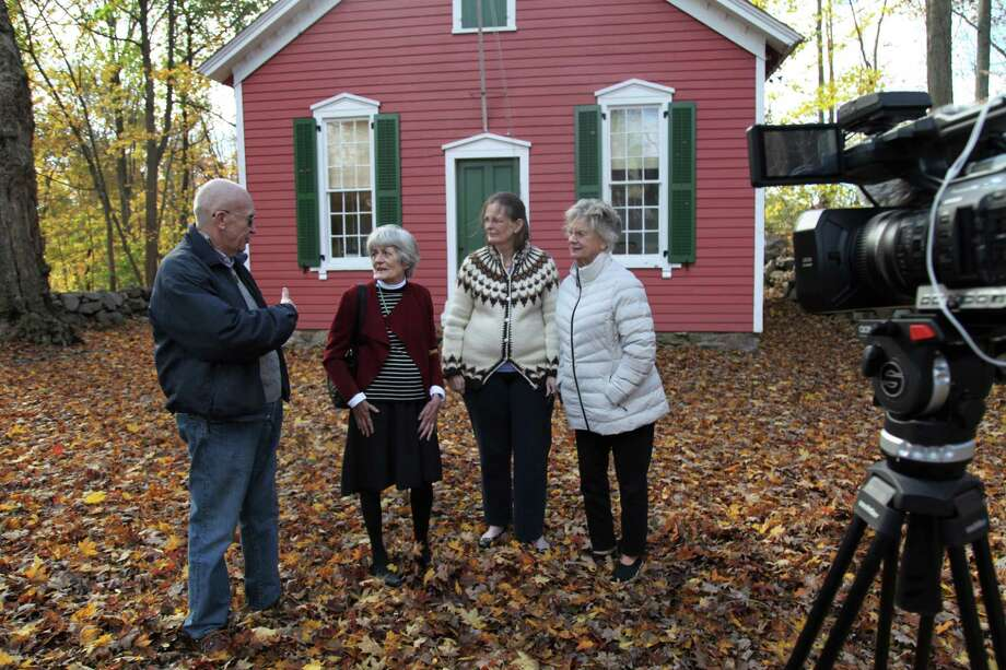 Former Little Red Schoolhouse students, from left, Joe Daley, Phoebe Ellsworth, Anne Sigurdsson and Deborah Carnes in front of the New Canaan school featured in John D. Murphy's documentary film. Photo: Contributed Photo /