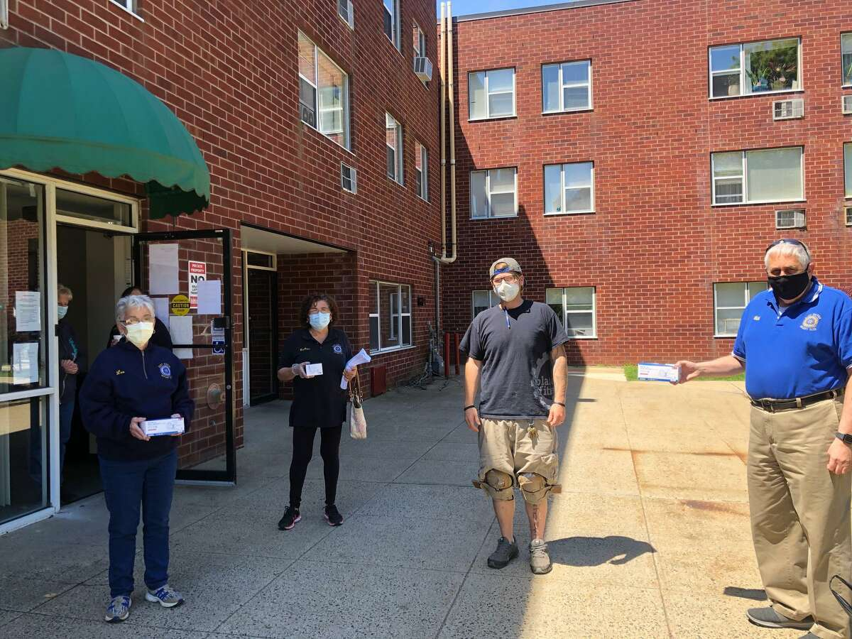 The East Haven Rotary Club recently had the opportunity to deliver 486 surgical masks, to help lessen the risk of COVID-19, to residents at Woodview Elderly Housing on North High Street and East Farm Village Apartments on Messina Drive. The masks were obtained through the generosity of East Hampton Rotarian Ted Rossi, who generously donated masks to each of the Connecticut Rotary Clubs to be passed onto the communities that they serve. The local clubs then in turn made donations to the Rotary International Foundation Annual Fund. Delivering the masks to East Farm Village were Rotarians Lee DeLoughery, Barbara Brow and Bill Richardson.