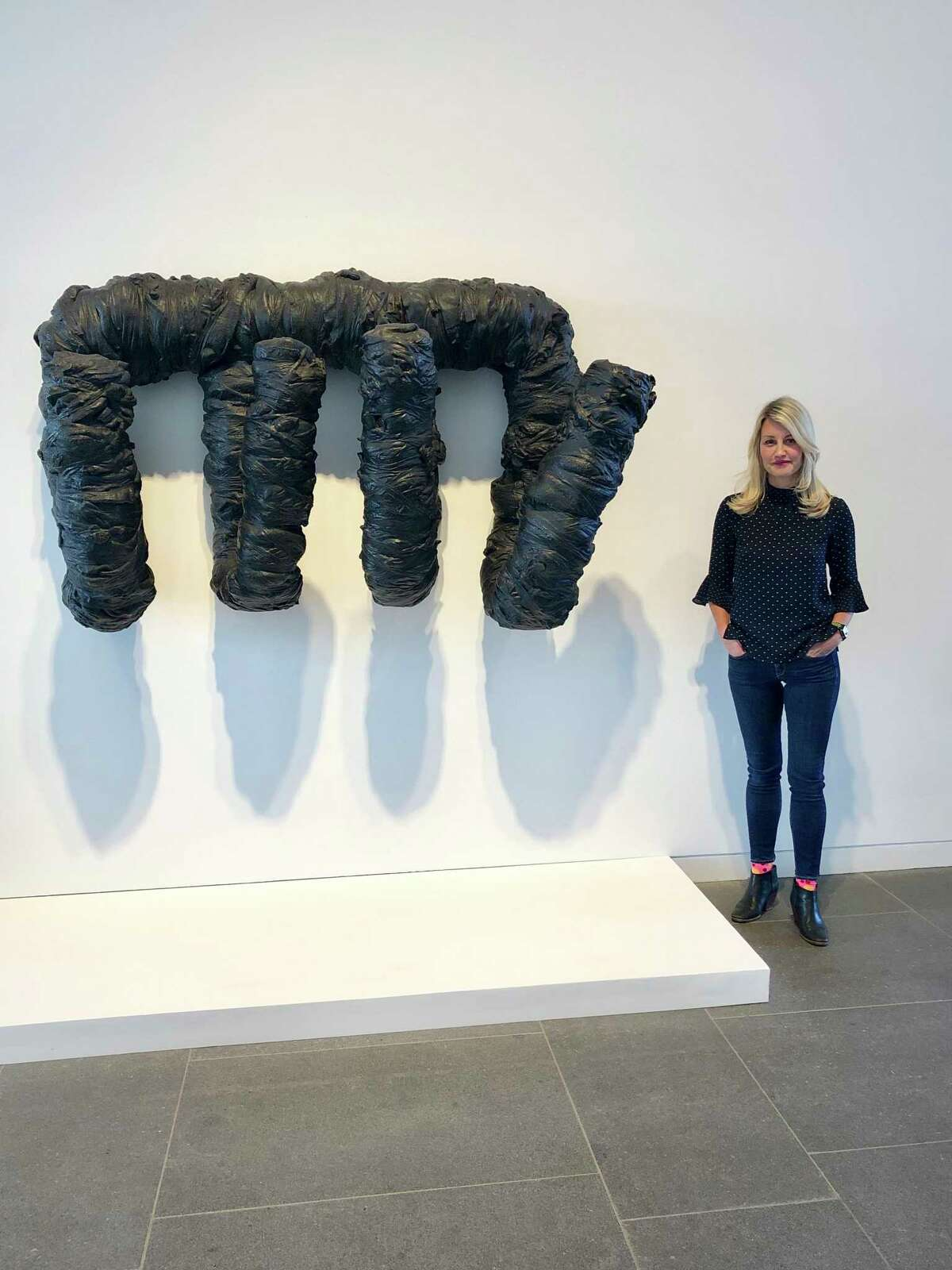The Aldrich Contemporary Art Museum's senior curator, Amy Smith-Stewart, poses with Harmony Hammond's work