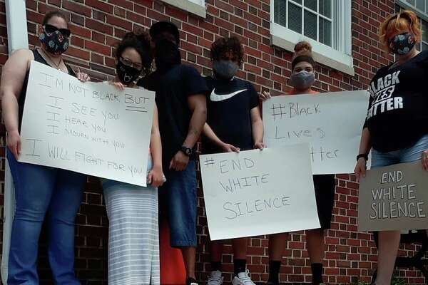 A photo from the Showing Up for Racial Justice Facebook page shows a group of protesters holding signs supporting the #BlackLivesMatter movement. (Courtesy Photo)