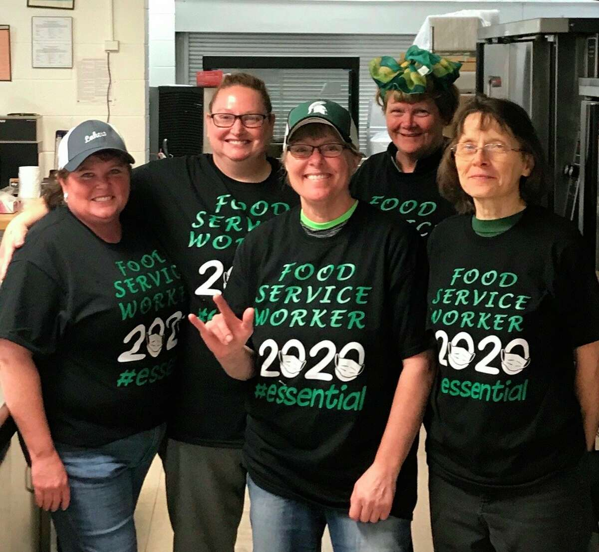 Laker Food Services Director Cinamon Marker, far left, and her team have prepared and distributed about 60,000 meals to students since schools closed in March. (Submitted Photo)