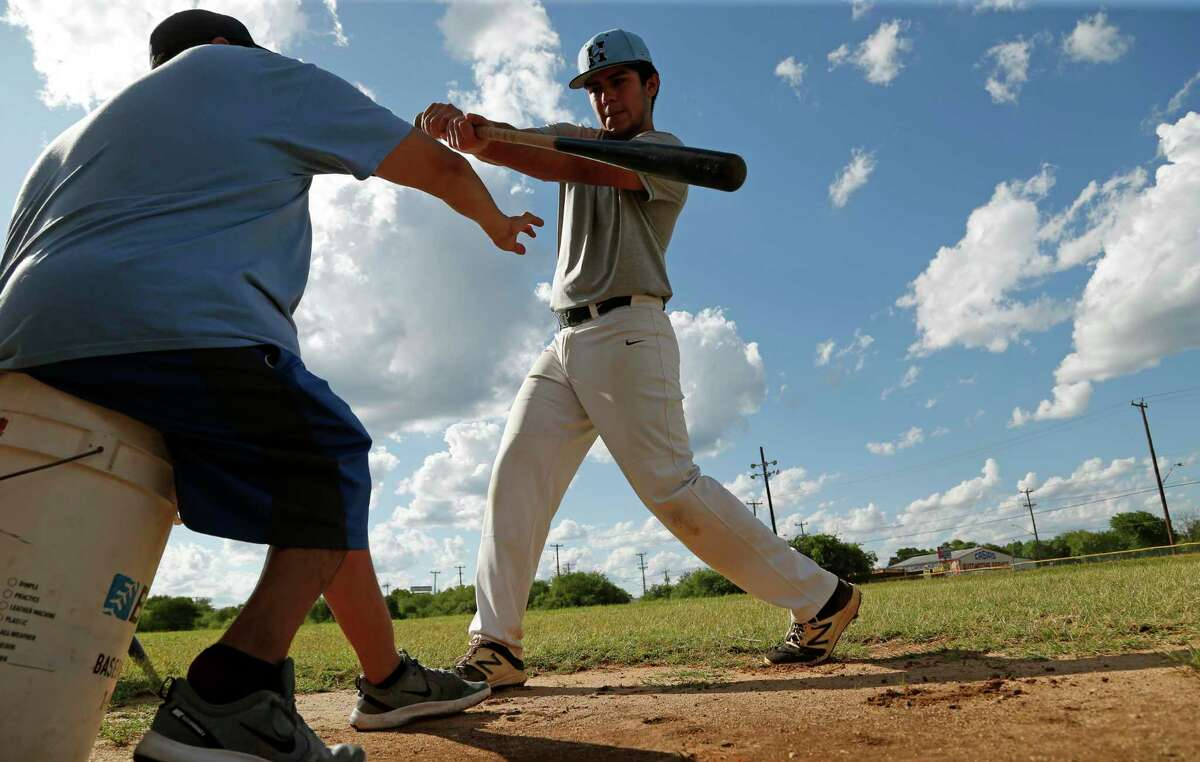 Joseph Medina of Harlan High School receives instruction from coach John Trevino before practice for TX Lions Select Baseball Club on Tuesday, May 26, 2020 at Beck Field. This club practices on a private field.