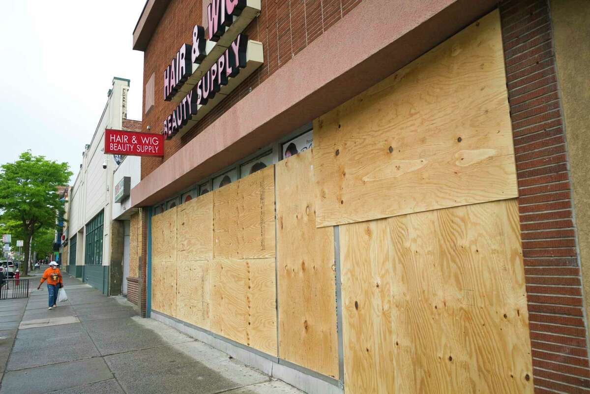 A store on Central Ave. is seen boarded up on Tuesday, June 2, 2020, in Albany, N.Y. Businesses up and down Central Ave. were damaged and had items stolen Saturday night. (Paul Buckowski/Times Union)