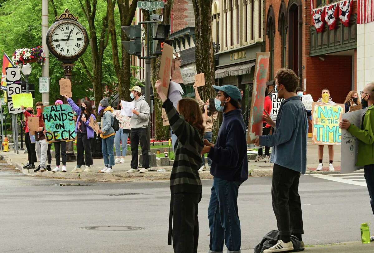 Peaceful protesters are seen along Broadway holding signs on Tuesday, June 2, 2020 in Saratoga Springs, N.Y. The protesters were gathered in response over the killing of George Floyd, an unarmed black man, by police in Minneapolis, MN. along with other black people such as Breonna Taylor and Ahmaud Arbery. (Lori Van Buren/Times Union)