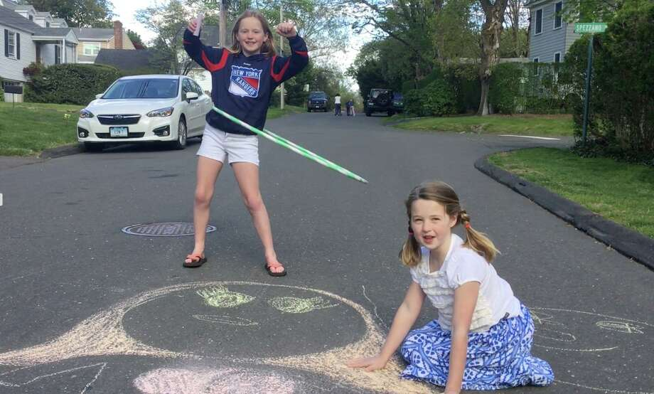 """On Friday, kids in Greenwich will be invited to take 'A Walk with Chalk' and draw lines as they head to friends' houses, walk to their schools or stop off at the Greenwich Boys & Girls Club, where they can pause to create artwork in the parking lot, along sidewalks and on the """"main canvas"""" of the club's semicircular driveway. Photo: Contributed"""