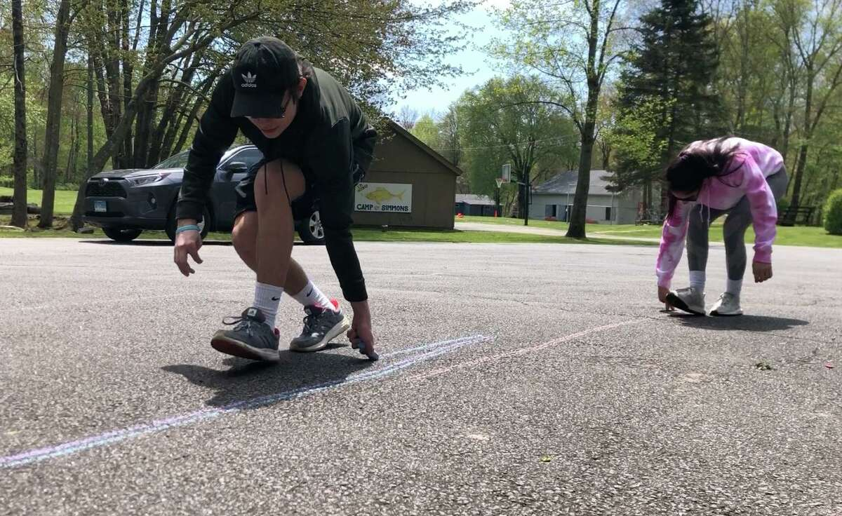 """On Friday, kids in Greenwich will be invited to take 'A Walk with Chalk' and draw lines as they head to friends' houses, walk to their schools or stop off at the Greenwich Boys & Girls Club, where they can pause to create artwork in the parking lot, along sidewalks and on the """"main canvas"""" of the club's semicircular driveway."""