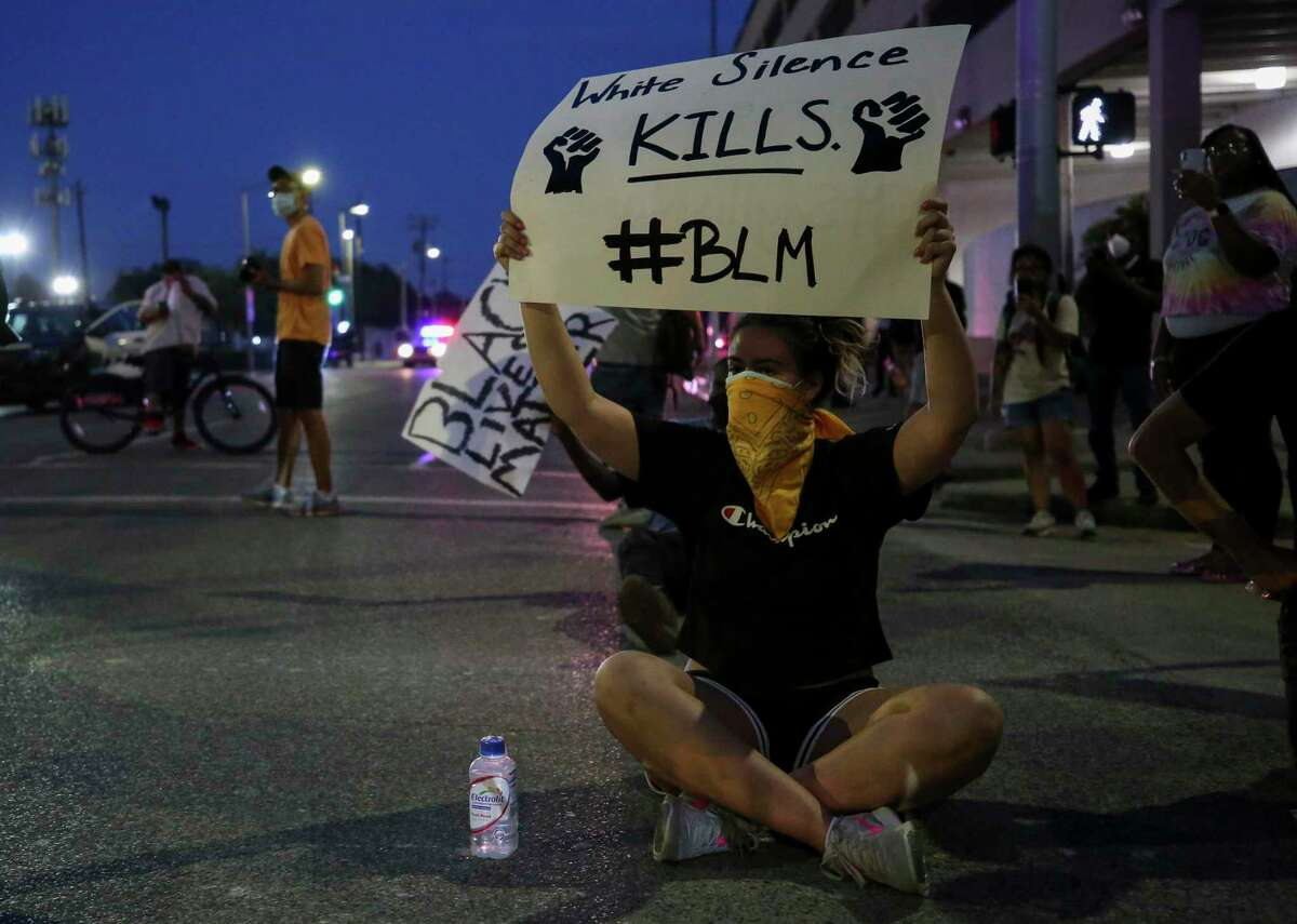Demonstrators marched through downtown in protest of George Floyd's death Saturday, May 30, 2020, in Houston. Floyd, died while in custody of Minneapolis Police last Monday night.