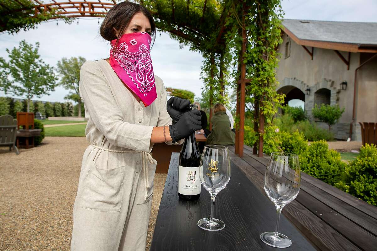 Sarah Hanson Citron opens a bottle of wine at Bricoleur Winery in Windsor, Calif. on Sunday, May 31, 2020.