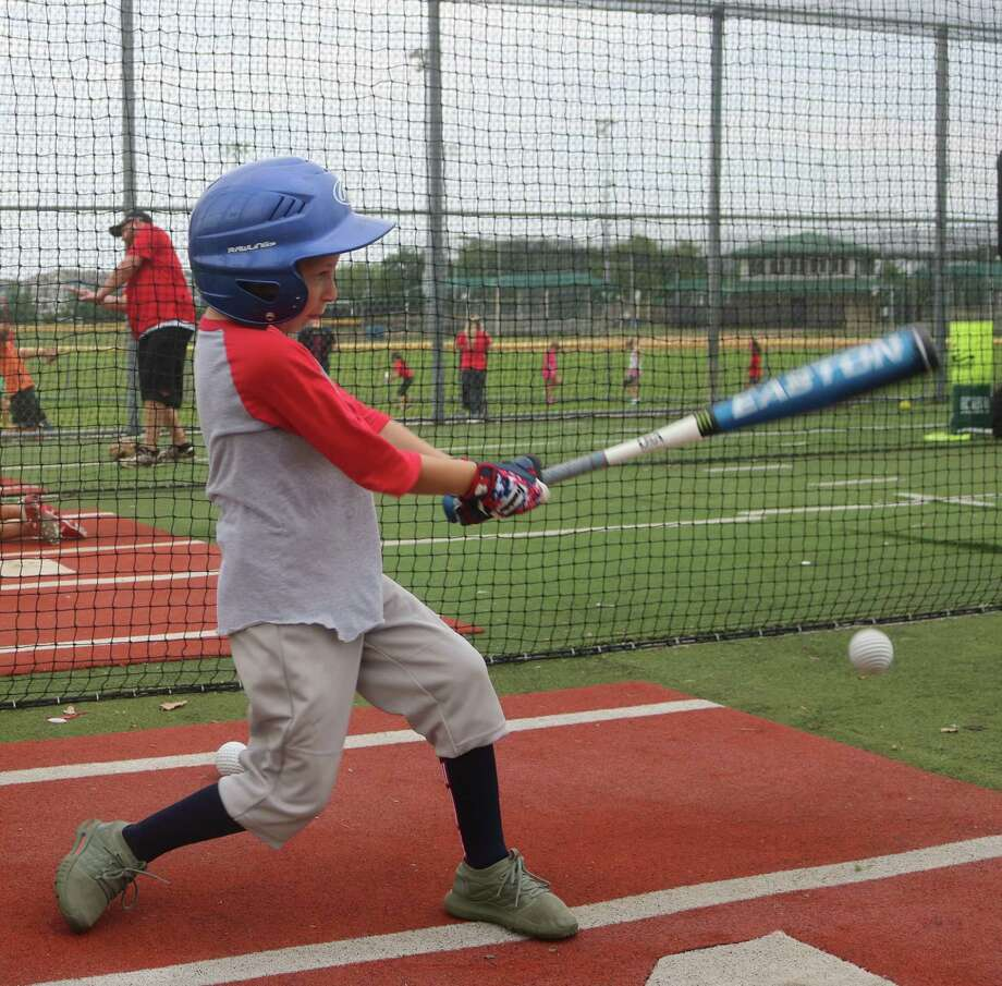 IronPigs player Dean Stanley takes his cuts in the Chester Davis Sportsplex batting cages Monday night. The cages were bubbling over with children hustling to get ready for the new opening day of June 15. Photo: Robert Avery
