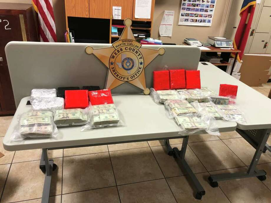 The Webb County Sheriff's Office said they seized these bundles of cash along Interstate 35, north of Laredo. Photo: Courtesy Photo /Webb County Sheriff's Office