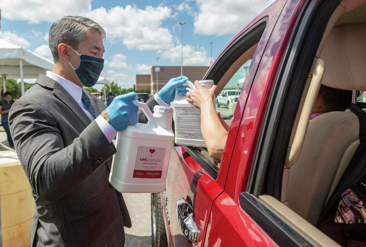 Mayor Ron Nirenberg hands out sanitizer last month to a business owner at the Alamodome. Many, but not all, readers appreciate Nirenberg's leadership during this pandemic.
