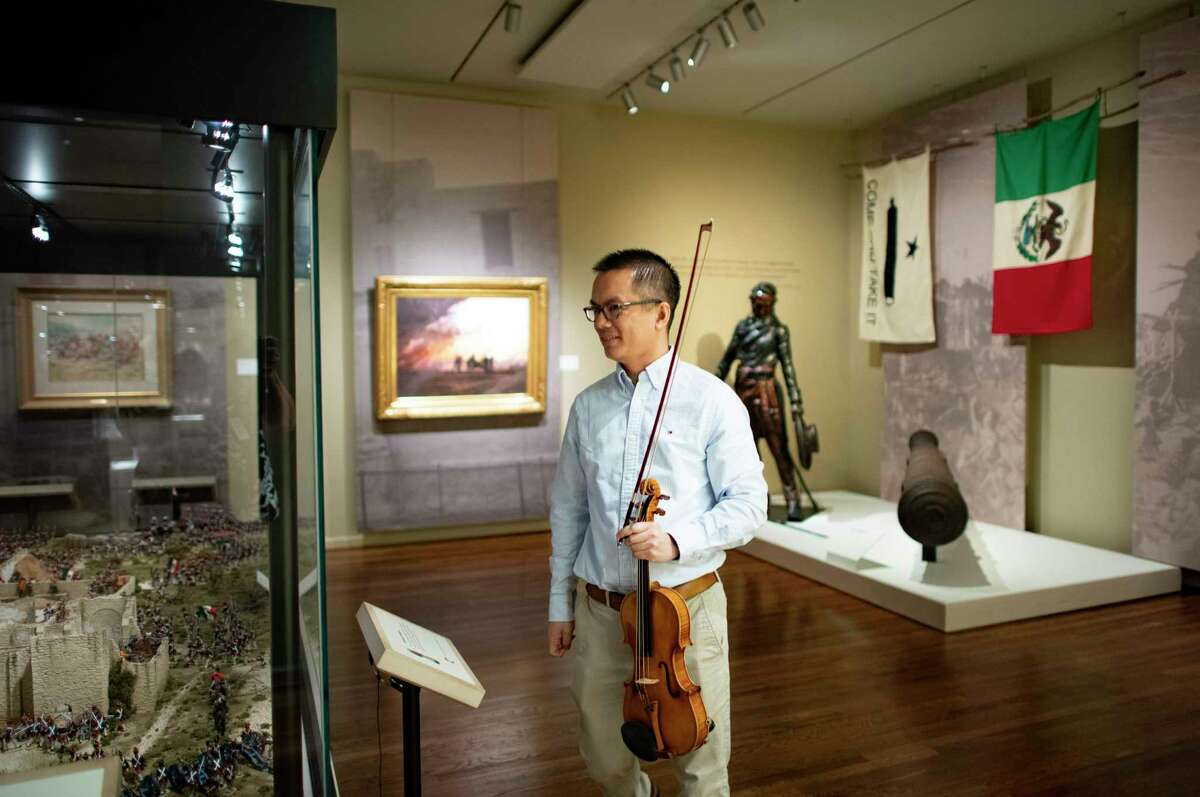 """Eric Siu of the San Antonio Symphony prepares to play """"Melodie"""" by Gluck for a filmed promo at the Briscoe Western Art Museum."""