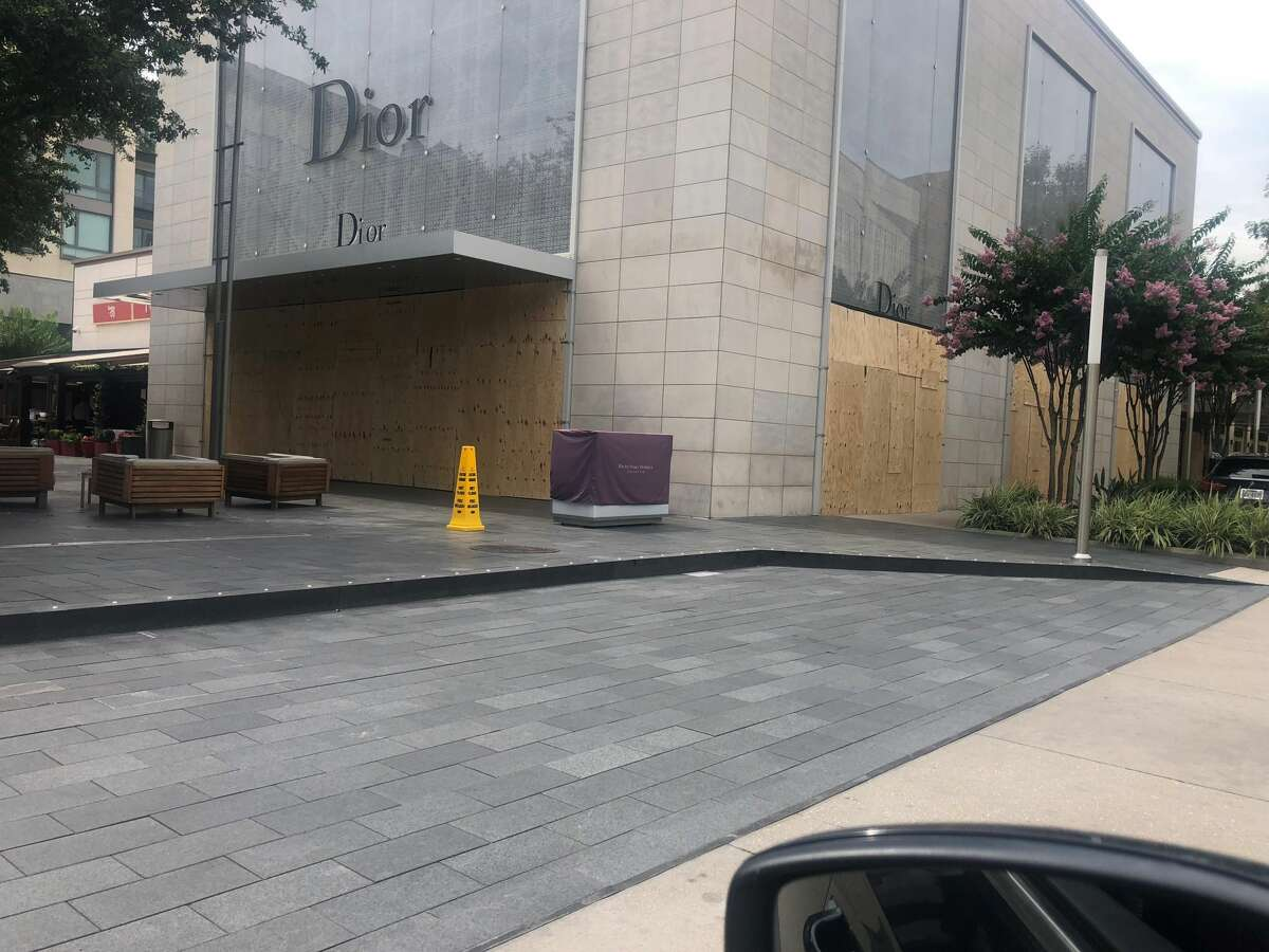 The Dior store is shown with boarded windows on Monday.