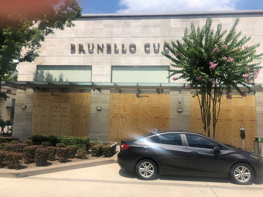 Brunello Cucinelli moved to board up its store over the weekend along with other boutique River Oaks Shopping District stores. Photo: Alison Medley