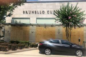 It's an eerie visual that shoppers stumble upon as they drive into the River Oaks Shopping District. Cartier, Dior, Harry Winston, Brunello Cucinelli have boarded up their luxury, boutique shops in River Oaks.