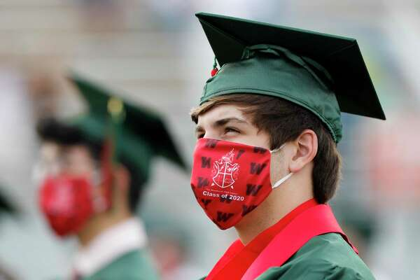 Tyler Beard listens to Principal Ted Landry during The Woodlands High School's graduation ceremony at Woodforest Bank Stadium, Tuesday, June 2, 2020, in Shenandoah.