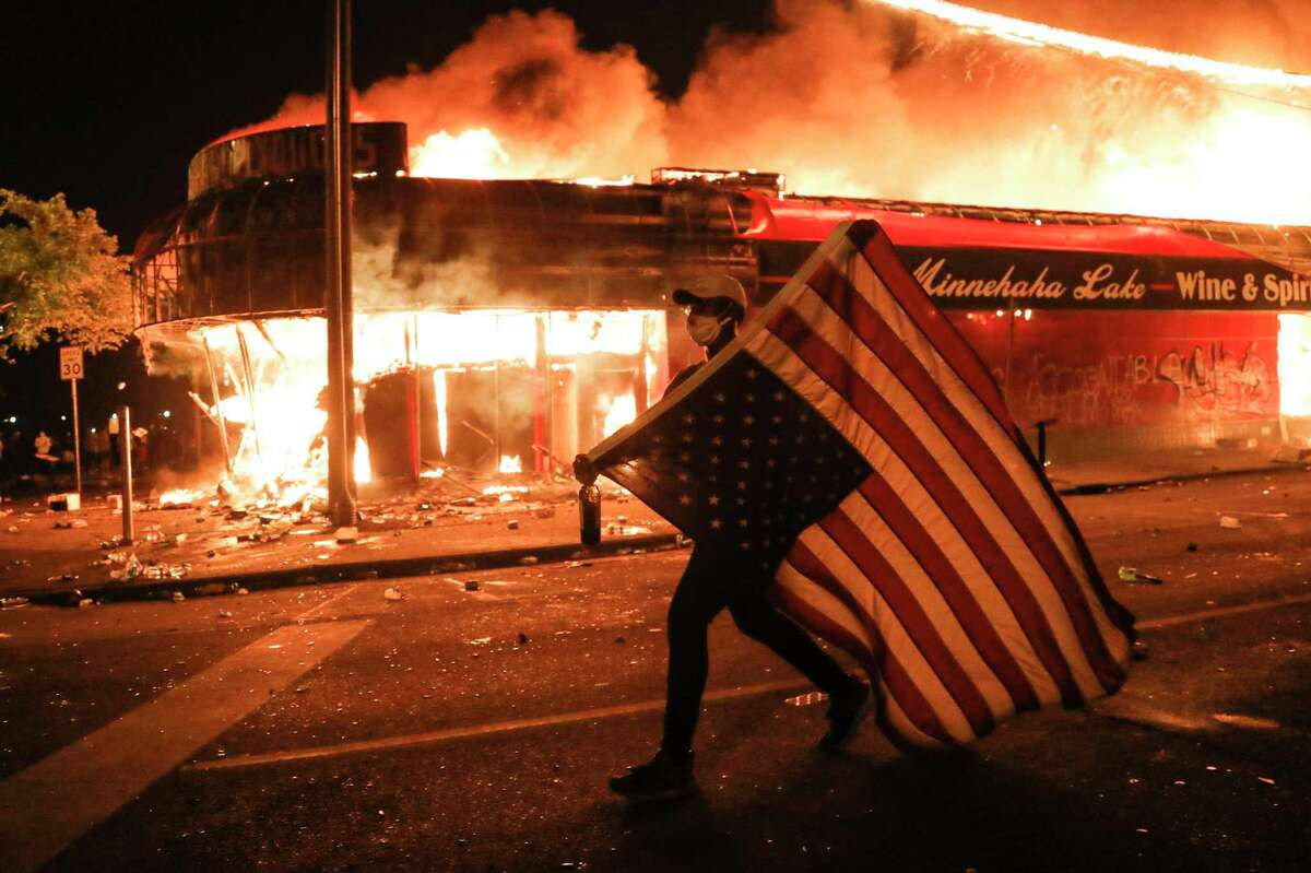 Even before the death of George Floyd death shocked the nation, sparking protests that burned across the nation. a reader warned his grandson of the dangers faced by young men of color. This protester in Minneapolis last week carries a U.S. flag upside down, a sign of distress.