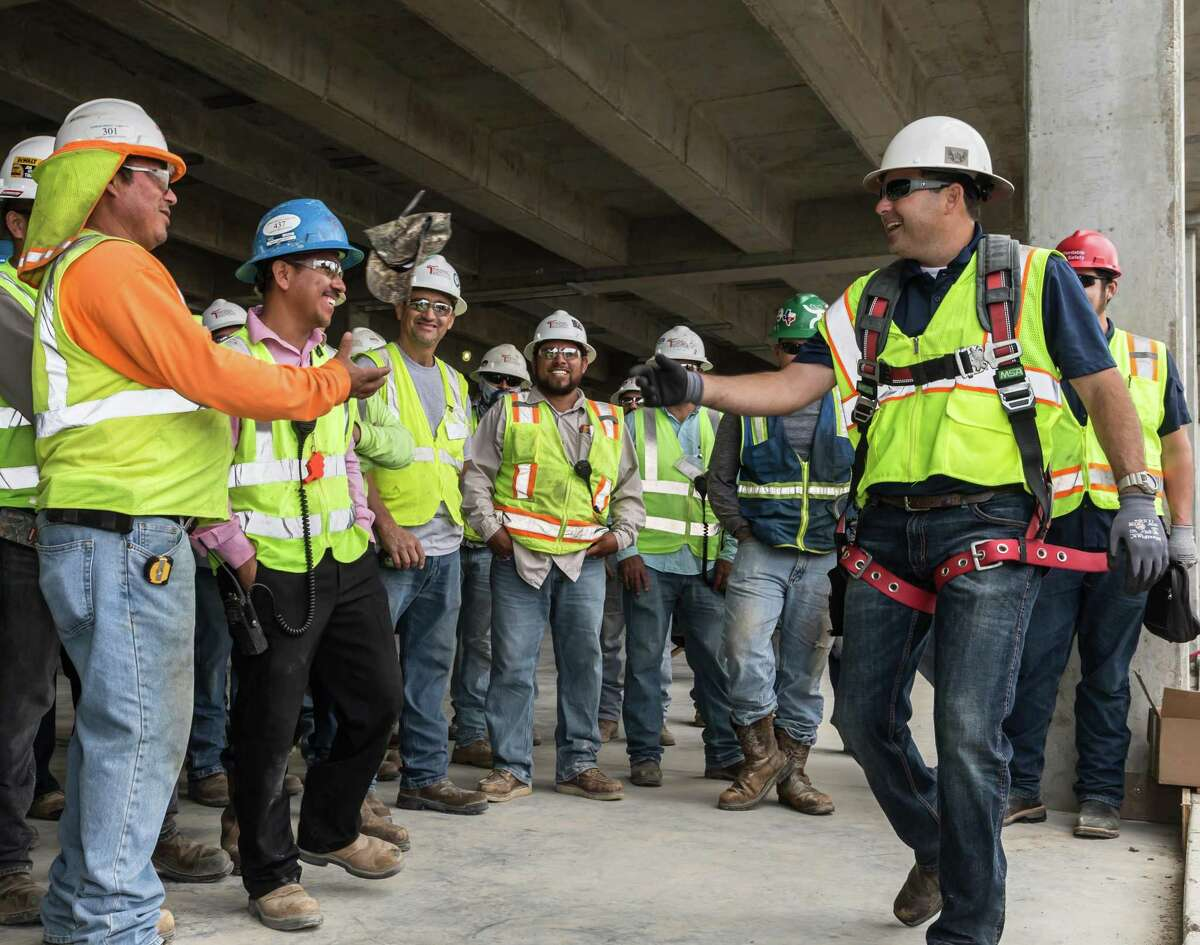 In this 2017 photo, construction workers participate in a safety training program held at an MD Anderson construction site in League City. Let's not forget that construction is another field of opportunity for those looking to retrain for a post-COVID 19 economy.