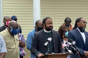 The Rev. Steven Cousin, pastor of Bethel AME Church in New Haven, speaks at a press conference Tuesday praising police handling of Sunday's Black Lives Matter protest.