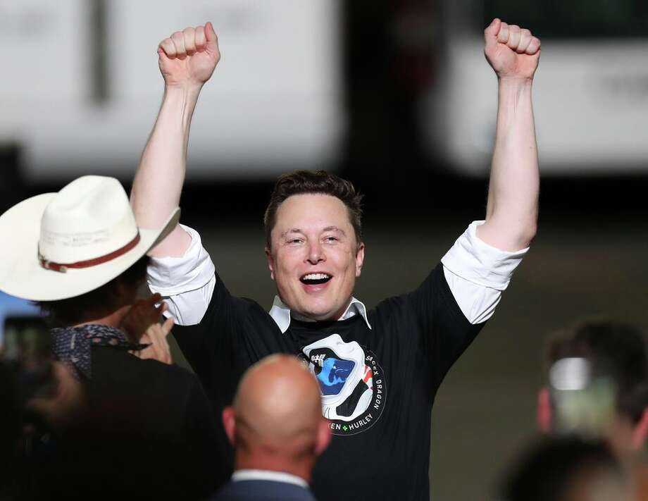 SpaceX founder Elon Musk celebrates after Saturday's successful launch of the SpaceX Falcon 9 rocket with NASA astronauts aboard. Photo: Joe Raedle/Getty Images