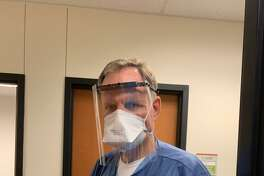Dr. Steven Coggins, an anesthesiologist at CHI St. Luke's Health-Patients Medical Center in Pasadena, wears a face shield developed by a team of students and faculty at San Jacinto College.
