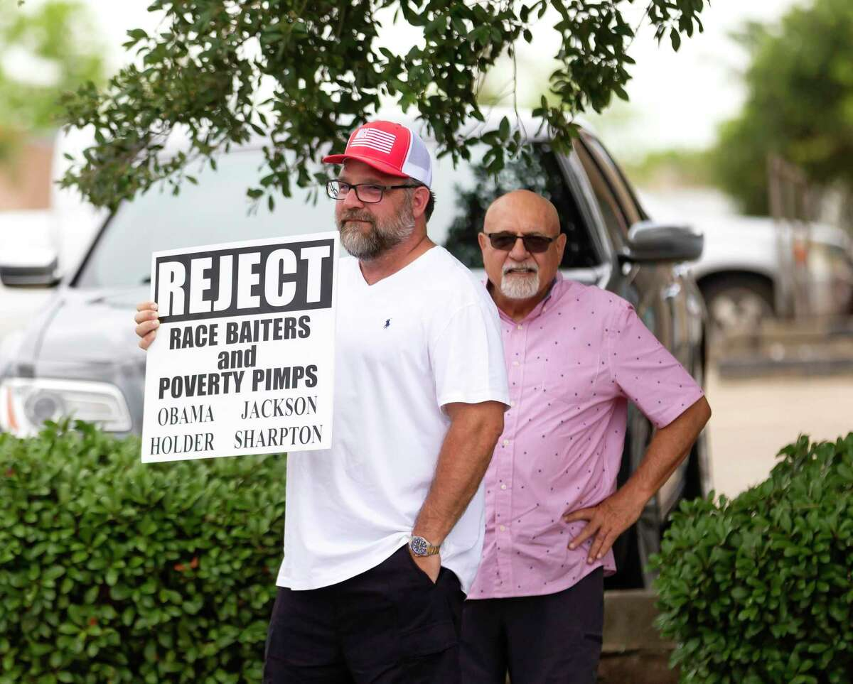 An attendee who didn't want to share their name said that if protestors were upset by their sign that they hoped they would go talk to them during a rally held at the intersection of 105 and Frazier in Conroe, Sunday, May 31, 2020.