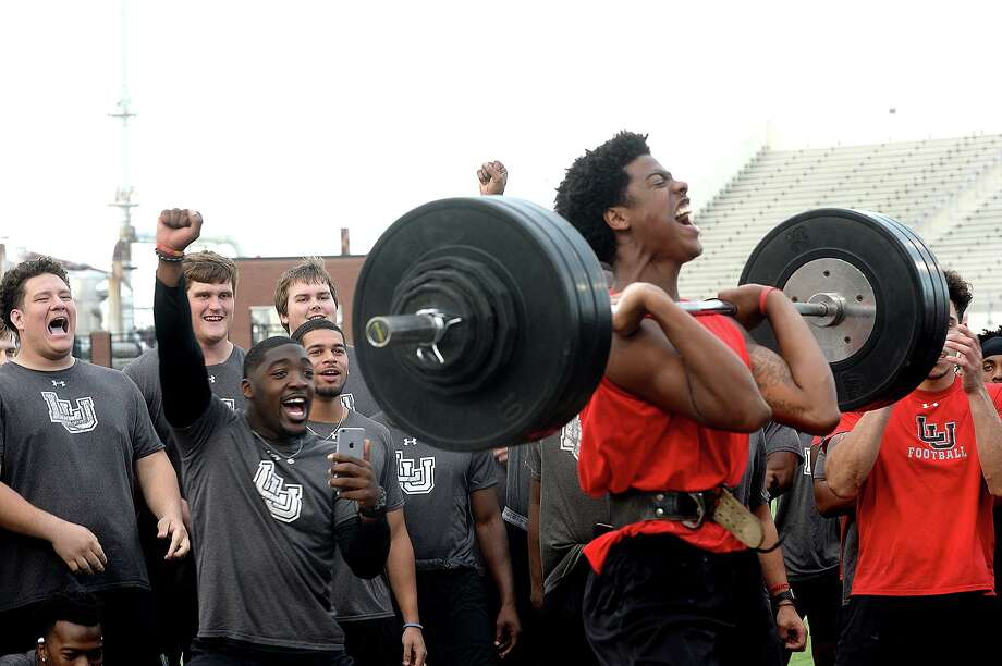 Lamar's teammates get in the spirit as Marcellus Johnson makes his next lift during the football team's annual Night of Champions weightlifting event on the football field Tuesday night.   Photo taken Tuesday, April 30, 2019 Kim Brent/The Enterprise Photo: Kim Brent / The Enterprise / BEN